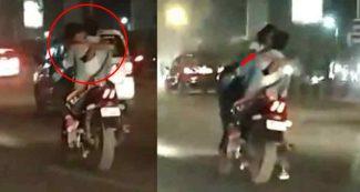 बीच सड़क बाइक के फ्यूल टैंक पर बैठकर लड़की और लड़के ने किया Kiss, वीडियो को IPS ने किया पोस्ट